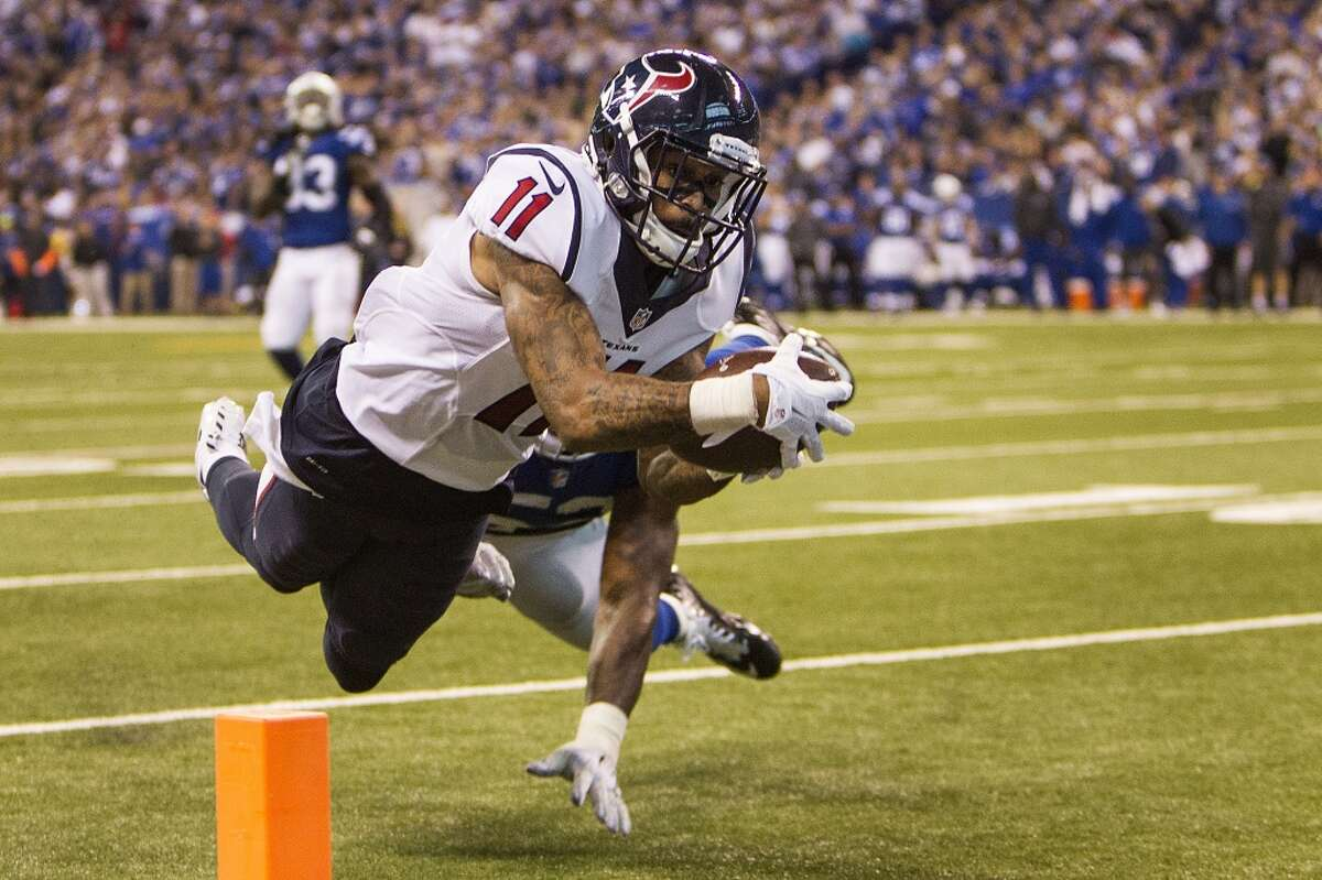 Houston Texans wide receiver Jaelen Strong (11) reaches for the end zone as he is hit by Indianapolis Colts inside linebacker D'Qwell Jackson (52) for an 8-yard touchdown reception during the fourth quarter of an NFL football game at Lucas Oil Stadium on Sunday, Dec. 20, 2015, in Indianapolis. The Texans beat the Colts 16-10, for the Texans' first win in Indianapolis in franchise history. ( Brett Coomer / Houston Chronicle )