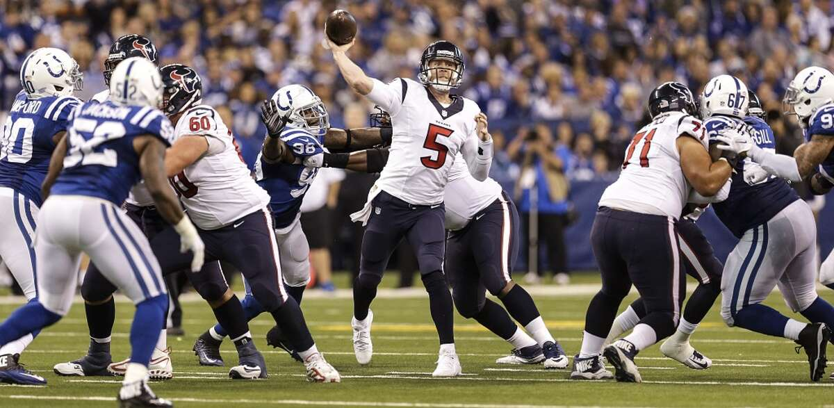 Houston Texans quarterback Brandon Weeden (5) throws a pass pressured by Indianapolis Colts outside linebacker Robert Mathis (98) during the third quarter of an NFL football game at Lucas Oil Stadium on Sunday, Dec. 20, 2015, in Indianapolis. ( Brett Coomer / Houston Chronicle )