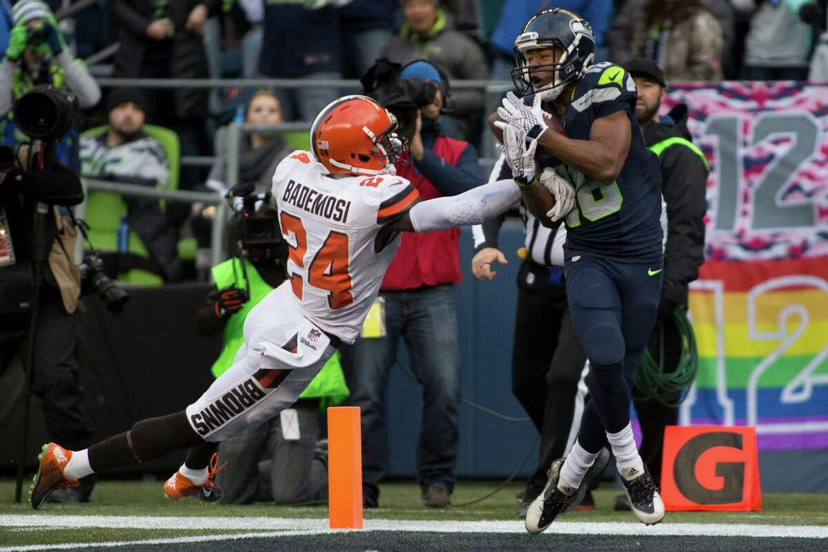 Seahawks' Tyler Lockett makes a catch while being guarded by Browns' Johnson Bademosi in the second half of an NFL football game at CenturyLink Field in Seattle on Sunday, Dec. 20, 2015.