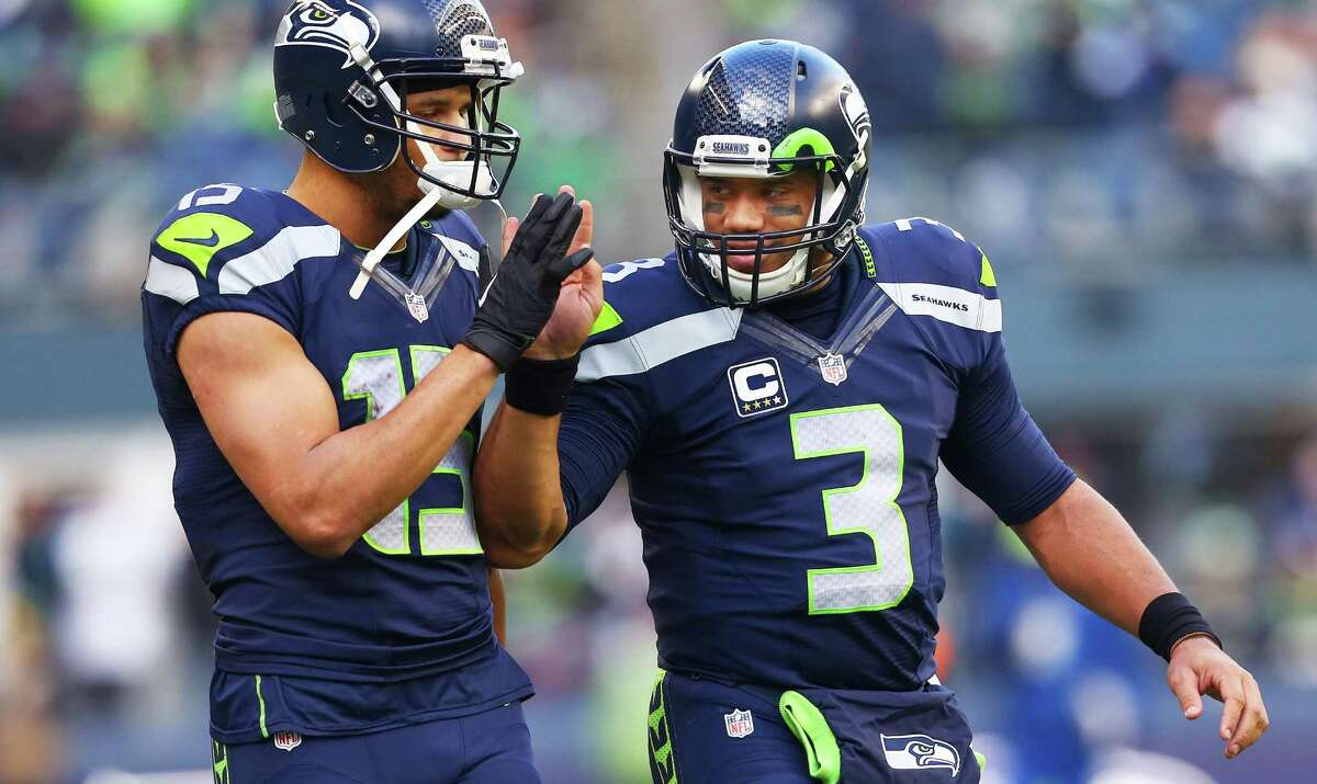 Seahawks' Jermaine Kearse gets a high-five from Russell Wilson during the third quarter of the Seahawks game against Cleveland, Sunday, Dec. 20, 2015 at CenturyLink Field. The Seahawks won 30-13.