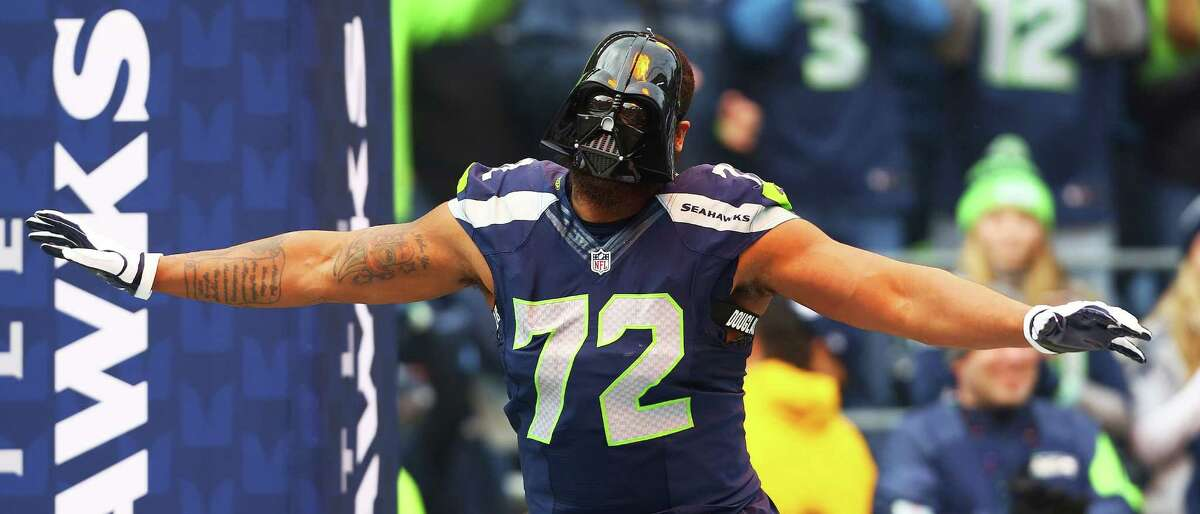 Seahawks' Michael Bennett takes the field wearing a Darth Vader mask before the start of the Seahawks game against Cleveland, Sunday, Dec. 20, 2015 at CenturyLink Field. The Seahawks won 30-13.