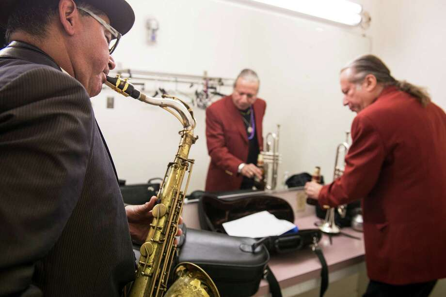 Joe Posada, left, and Al Gomez, right, warm up backstage at Guadalupe Theater during Holiday Saxophones on Sunday, December 20, 2015. Photo: Matthew Busch, For The San Antonio Express-News / Matthew Busch / © Matthew Busch