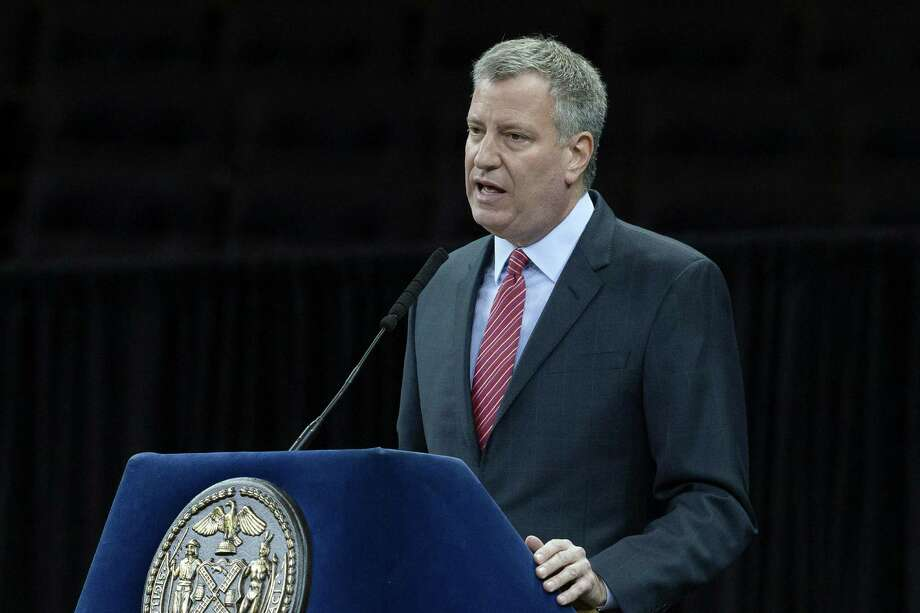 File-This Dec. 29, 2014, file photo shows New York City Mayor Bill de Blasio speaking during a New York Police Academy graduation ceremony at Madison Square Garden in New York. In the aftermath of last month's terror attacks in Paris, New York City not only bolstered security but quietly stepped up outreach efforts to its Muslim community. It aimed to calm fears about any hate-filled retaliation while trying to extend government services to a community that often has felt neglected. (AP Photo/John Minchillo, File) ORG XMIT: NY109 Photo: John Minchillo / FR170537 AP