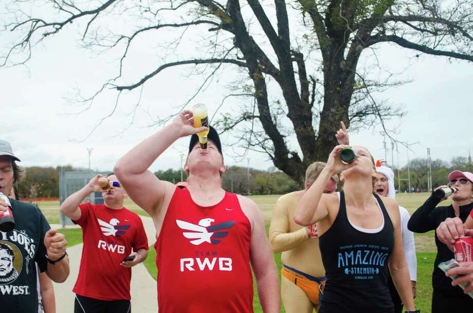 Four beers, one mile that was the order for the annual Beer Mile run at Olmos Park. Run a quarter mile, chug a beer. Here is a look at the sudsy race. Photo: Mark A. Zuniga, By   Mark A. Zuniga, For MySA.com / Mark A. Zuniga