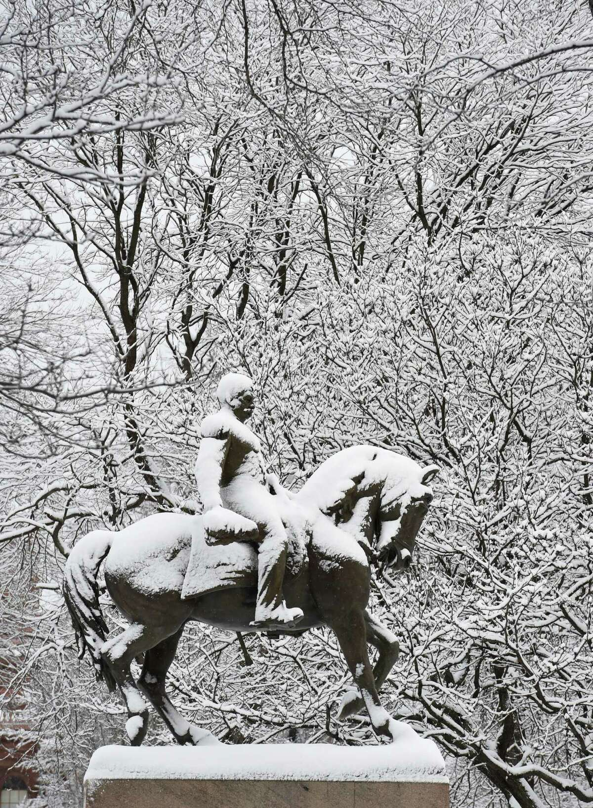 The stature of General Sheridan is snow covered and flanked by trees with snow attached to their limbs Thursday morning in front of the State Capitol Dec. 11, 2014 in Albany, N.Y. (Skip Dickstein/Times Union)