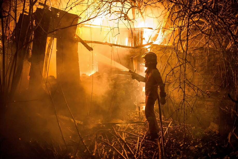 A members of UME (Unit Military Emergency) tries to put out a wild fire in Carrio, northwest Spain on December 20, 2015. Some 230 firefighters were dispatched to battle around 100 wildfires which broke out in northwest Spain on Saturday night, emergency services told AFP, but there were no reports of casualties. Photo: Jesus Vecino, AFP / Getty Images