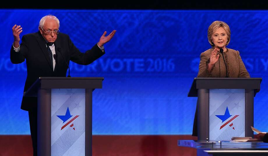Bernie Sanders and Hillary Clinton participate in the Democratic Presidential Debate hosted by ABC News at Saint Anselm College in Manchester, New Hampshire, on December 19, 2015. Photo: Jewel Samad, AFP / Getty Images
