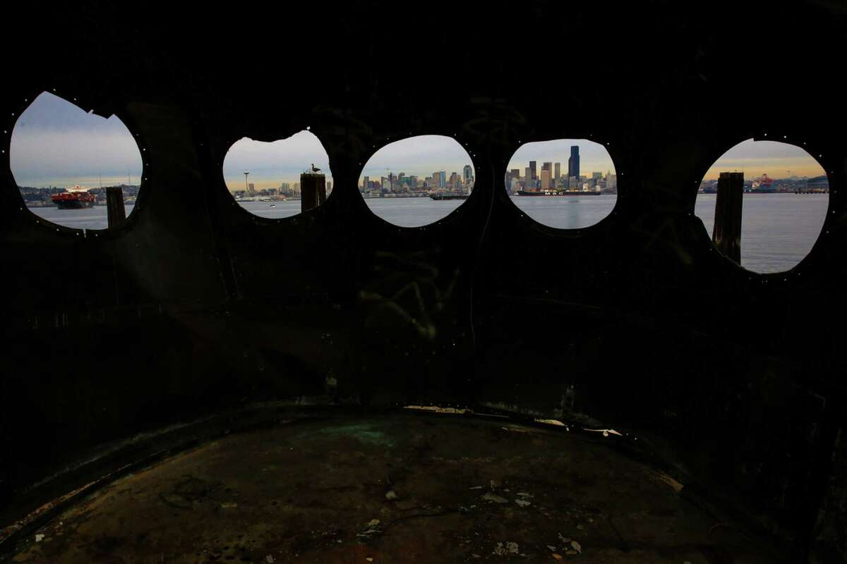 The city is shown through the wheelhouse windows of the historic ferry Kalakala outside of Salty's on Alki. Salty's restaurant owner Gerry Kingen purchased parts of the historic ferry Kalakala after the ship was dismantled. After years of efforts to preserve the ferry, it finally met its end at in Tacoma shipyard. Photographed on Wednesday, Feb. 11, 2015.