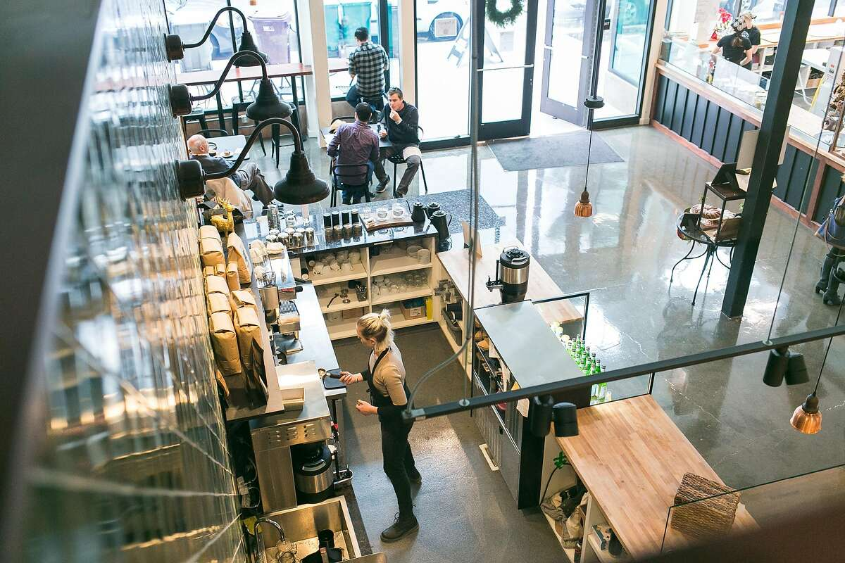 An overhead view of the coffee bar and open retail space inside of Firebrand Artisan Breads.