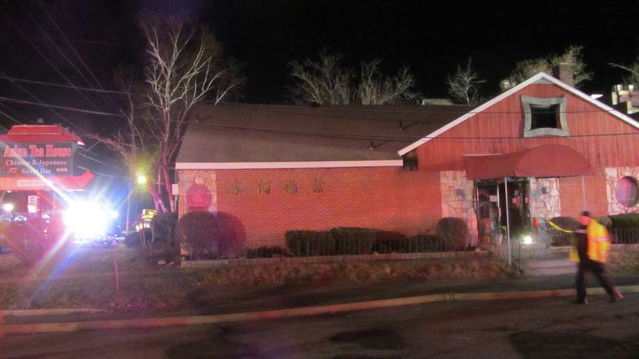 Fire was reported around 4 a.m., Monday at the Asian Tea House at 117 Columbia Turnpike in East Greenbush. Officials at the scene said the damage was mostly contained to the interior and there were no injuries. (Bob Gardinier / Times Union)