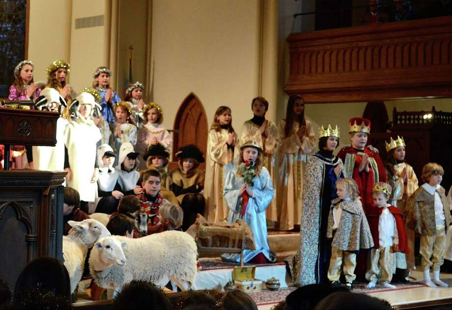 The 91st Christmas Nativity pageant at Trinity Episcopal Church featured a cast of more than 50 children and six animals Sunday afternoon. Photo: Jarret Liotta / For Hearst Connecticut Media / Fairfield Citizen