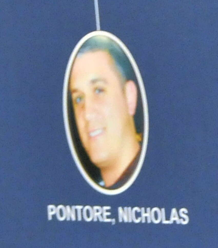 A photo of Nicholas Pontore is displayed during a press conference on Tuesday, August 4, 2015, at The New York State Police Academy in Albany, N.Y. (Phoebe Sheehan/Special to The Times Union) ORG XMIT: MER2015101908265701