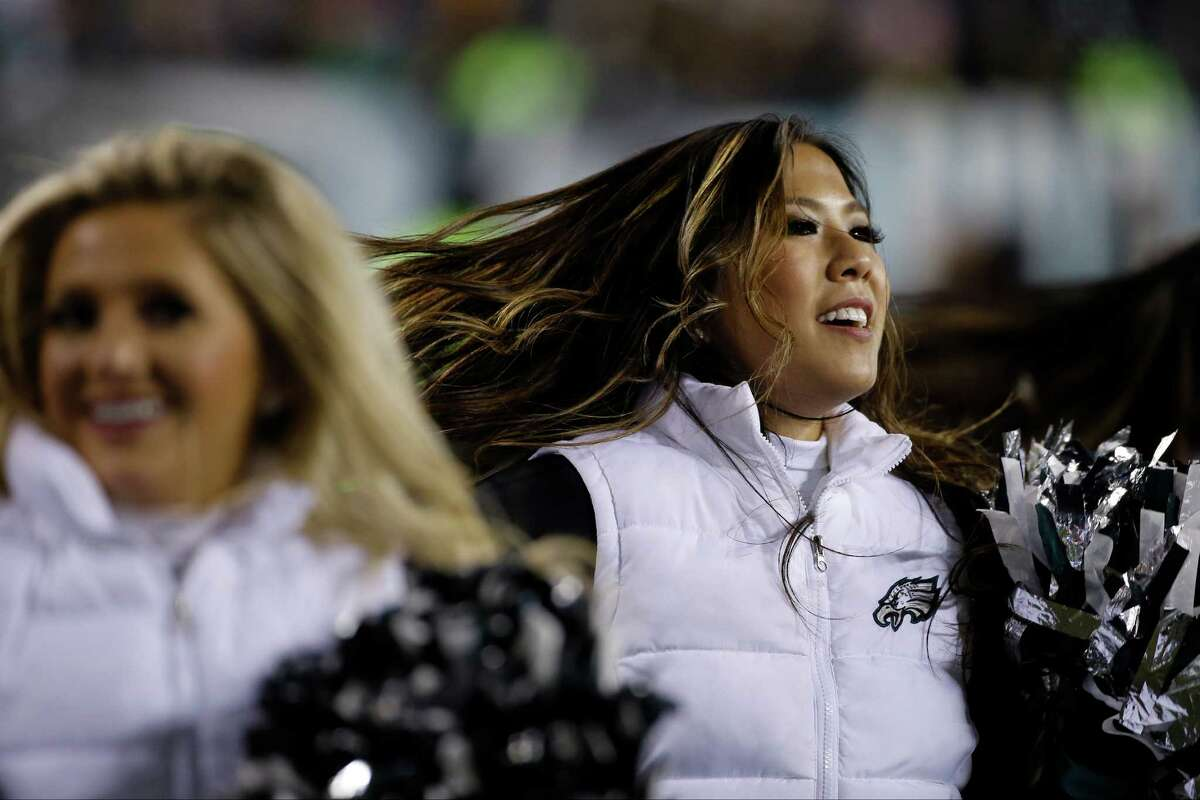 A Philadelphia Eagles' cheerleader performs during the second half of an NFL football game against the Arizona Cardinals, Sunday, Dec. 20, 2015, in Philadelphia. (AP Photo/Michael Perez)