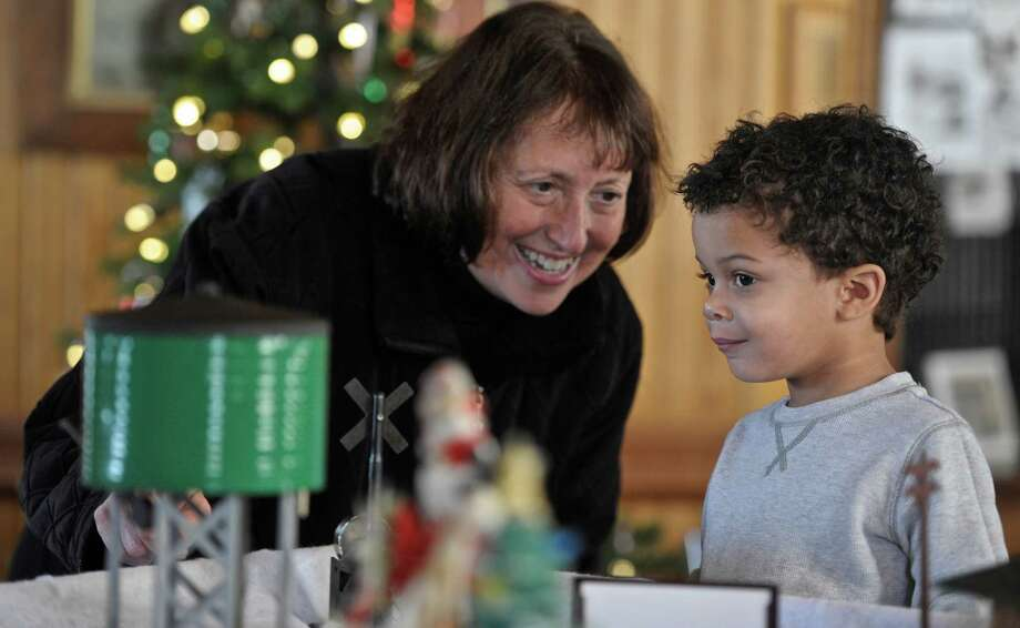 Roy Davidson, 2, looks over one of the displays at the Greater New Milford Chamber of Commerce 28th annual Hands-On Train Display with his grandmother Rachel Spillane, of New Milford, on Saturday, December 19, 2015, in New Milford, Conn. Photo: H John Voorhees III / Hearst Connecticut Media / The News-Times