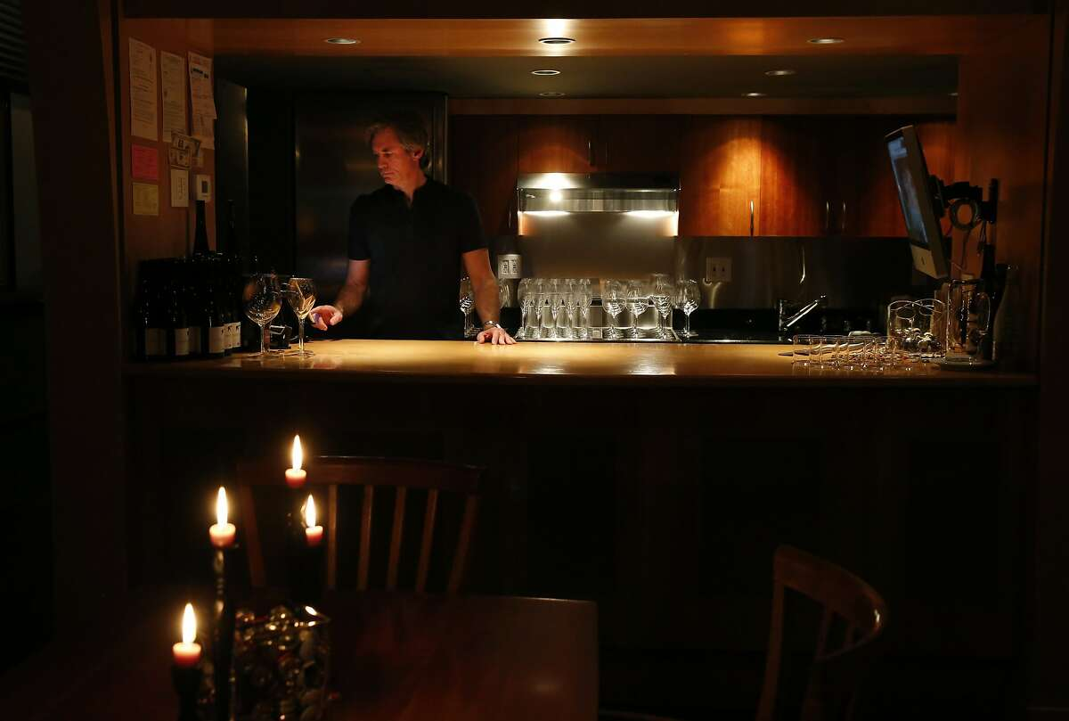 Bill Marci waits for his first reservations of the evening at the San Francisco Champagne Society in Marci's apartment Dec. 19, 2015 in San Francisco, Calif.