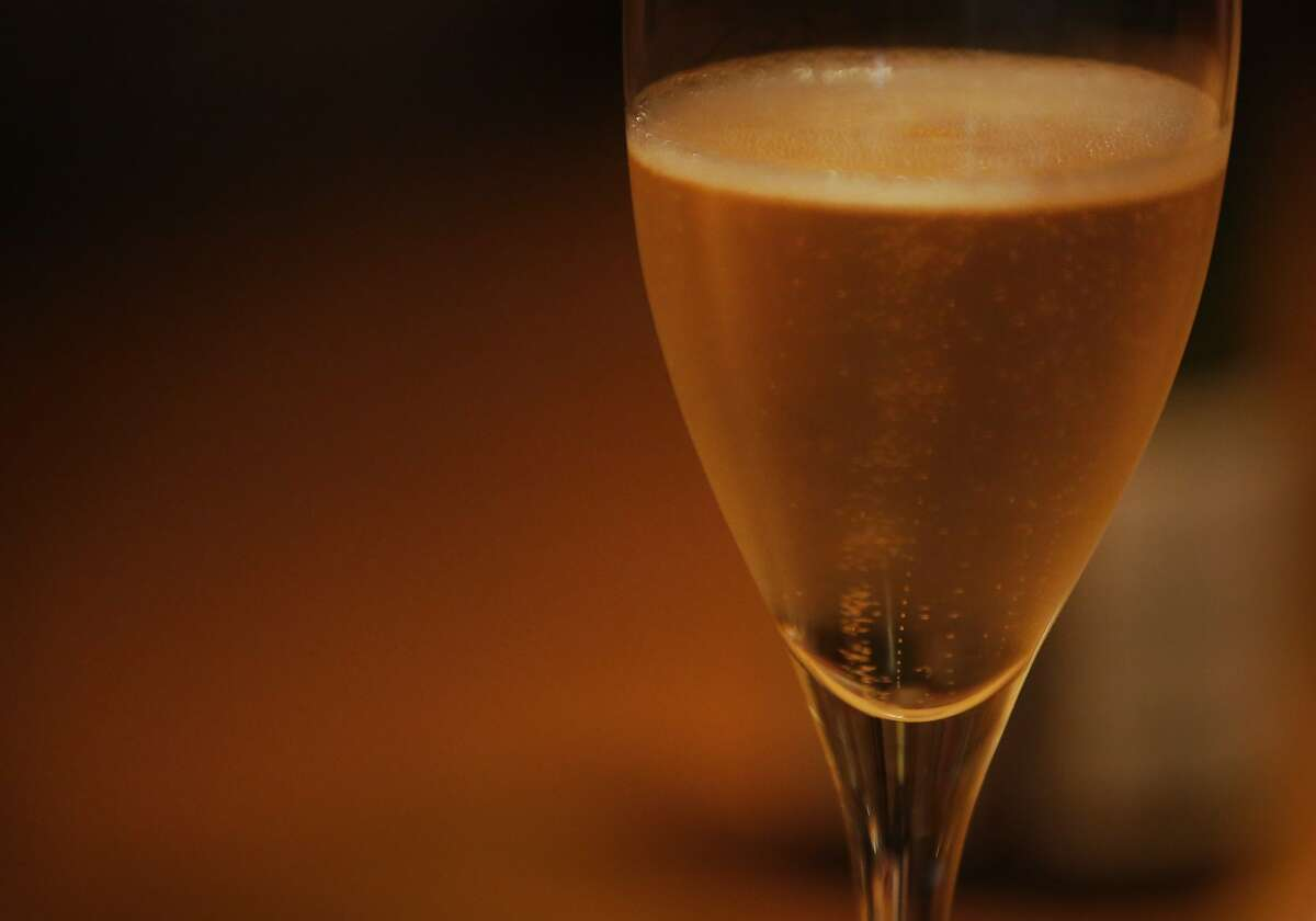 Bubbles find the surface during a pouring at the San Francisco Champagne Society in Bill Marci's apartment Dec. 19, 2015 in San Francisco, Calif.