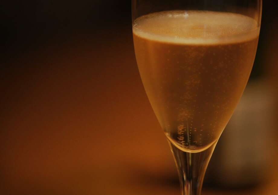 A glass of Champagne at a pouring at the San Francisco Champagne Society. Photo: Leah Millis, San Francisco Chronicle