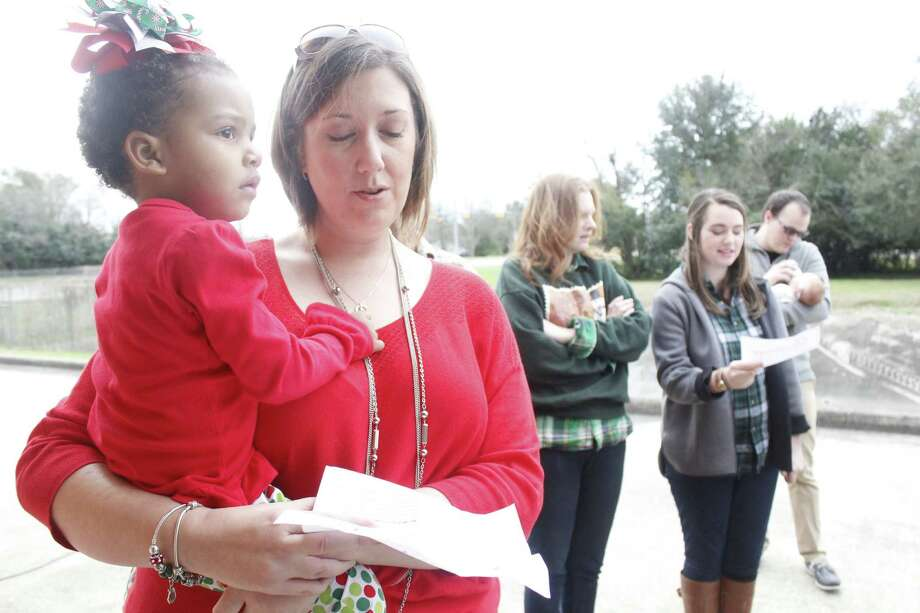 """Frankie and Tara Johnson sing carols for firefighters at Fire Station No. 6 in Beaumont for Praise Church's """"Sunday before Christmas"""" outreach program. Photo: Michelle Heath"""