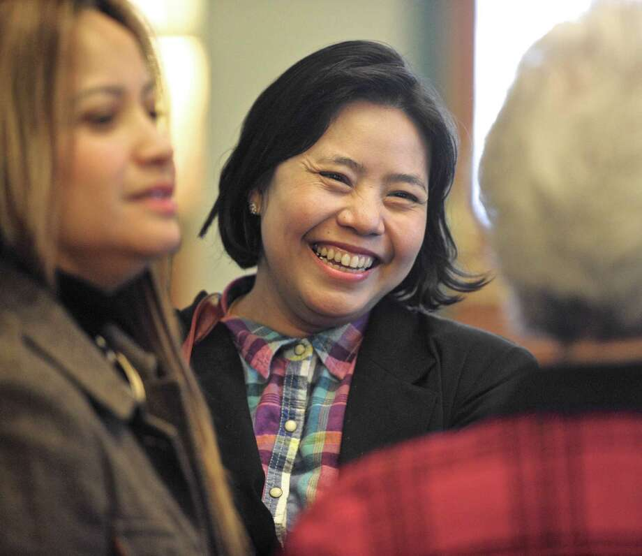 Myat Tun, center, of New Milford, smiles as she talks with Maria Elena Kamt, left, and Ann Vallombroso at the New Milford Town Hall. Tun and Kamt received certificates from New Milford Mayor David Gronbach. They have both recently become naturalized citizens of the United States. Vallombroso was their citizenship instructor; she is with Literacy Volunteers. Tun emigrated from Myanmar and Kamt from Peru. Photo: H John Voorhees III / Hearst Connecticut Media / The News-Times
