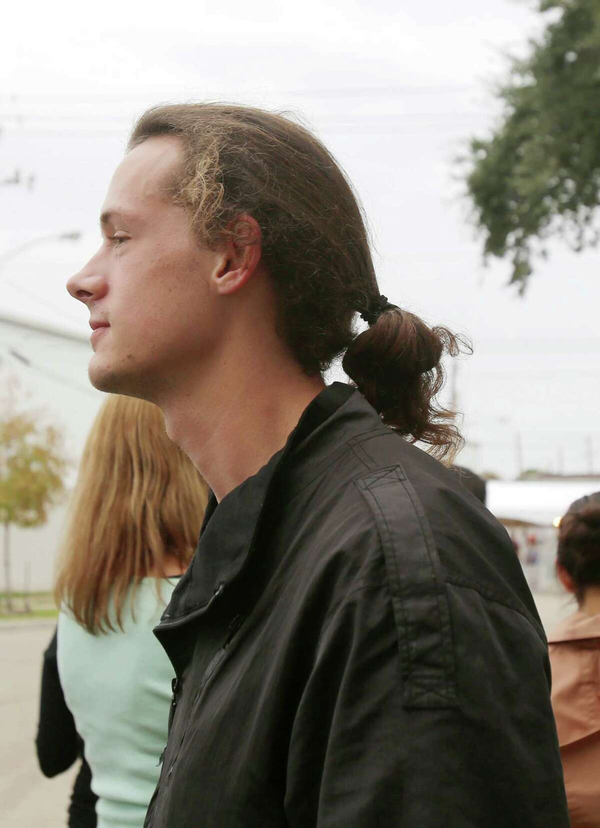 Man buns at Day for Night Festival Sunday, Dec. 20, 2015, in Houston.