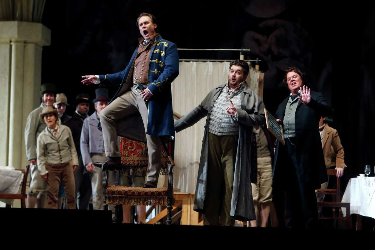 """Brandon Jovanovich (left) as Walther, James Rutherford as Hans Sachs and Martin Gantner as Sixtus Beckmesser in San Francisco Opera's """"Die Meistersinger."""""""