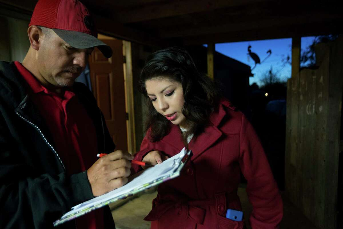 Jose and his daughter Maria Sosa, 20, revise estimates for several fencing jobs they are working on. Maria Sosa is the owner of the family business which specializes in fencing and construction work. Thursday, Nov. 19, 2015.