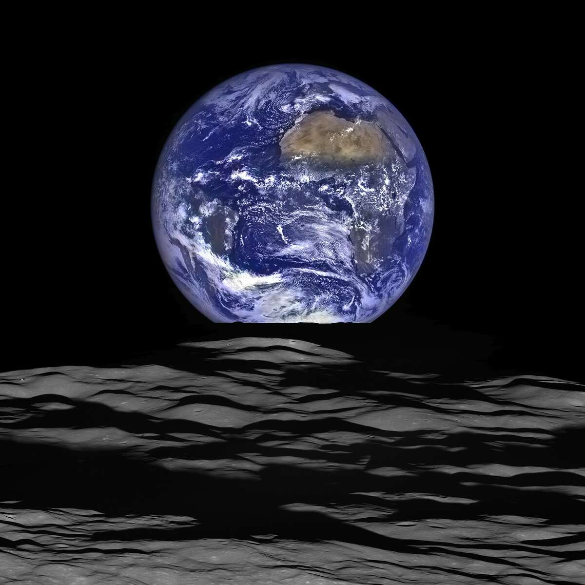 This NASA image released December 18, 2015, shows what NASA's Lunar Reconnaissance Orbiter (LRO) recently captured in a view of Earth from the spacecraft's vantage point in orbit around the moon. In this composite image we see Earth appear to rise over the lunar horizon from the viewpoint of the spacecraft, with the center of the Earth just off the coast of Liberia. The large tan area in the upper right is the Sahara Desert and just beyond is Saudi Arabia. The Atlantic and Pacific coasts of South America are visible to the left. AFP PHOTO / NASA/HANDOUT/Getty Images