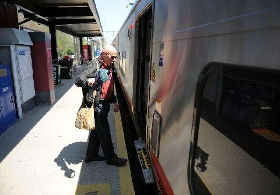 Passenger boards Metro North train Photo: File Photo / Hearst Connecticut Media