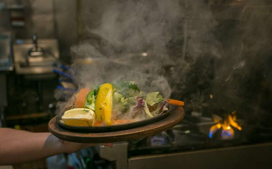The Tandoori Fish comes steaming from the stove at Guddu de Karahi in San Francisco. Photo: John Storey, Special To The Chronicle