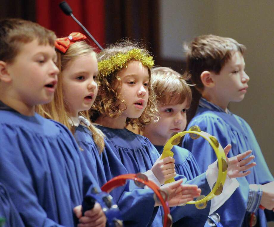 The Cherub Choir performs during the Children's Christmas Eve service at the First Congregational Church in Old Greenwich in 2014. A full day worth of music and celebration is again planned on Christmas Eve. Photo: Bob Luckey / Bob Luckey / Greenwich Time