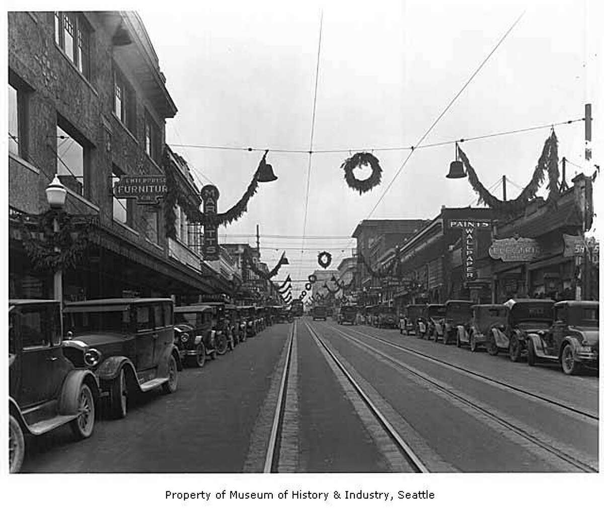 This photo from 1926 shows University Way, or The Ave, decorated for Christmas. Photo courtesy MOHAI, PEMCO Webster and Stevens Collection, image number 1983.10.3434.2.