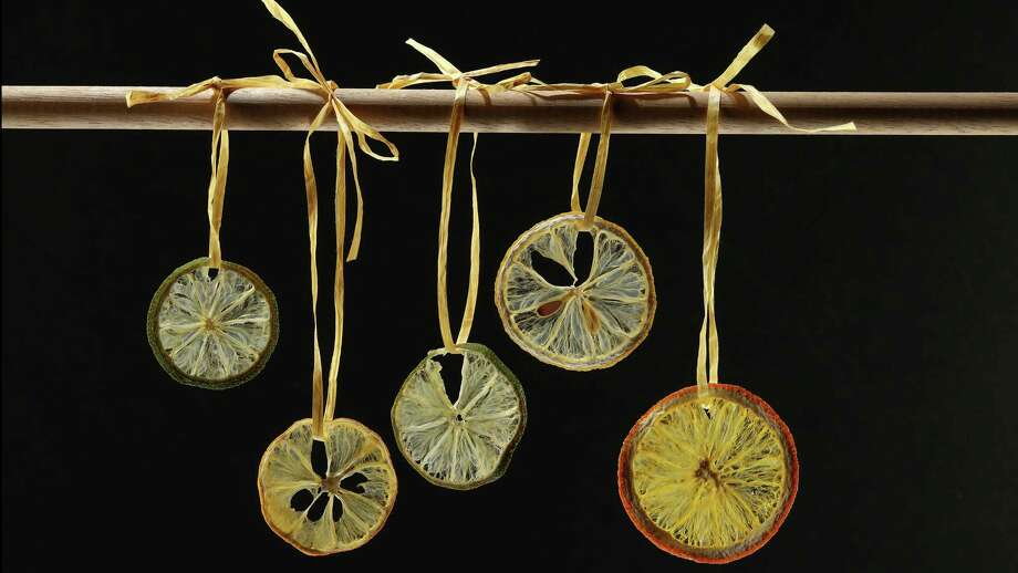 Lemon and orange slices dry into pretty wheels to use as garnishes for drinks or baked goods, or as ornaments or even gift tags. Photo: E. Jason Wambsgans /TNS / Chicago Tribune