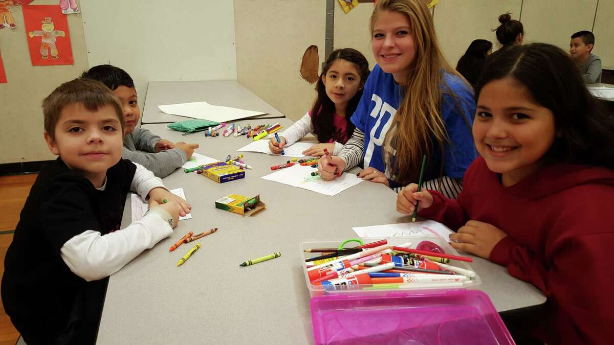 Third-grade students at Roxbury Elementary School make holiday cards for patients in hospice care as part of their service-learning projects.