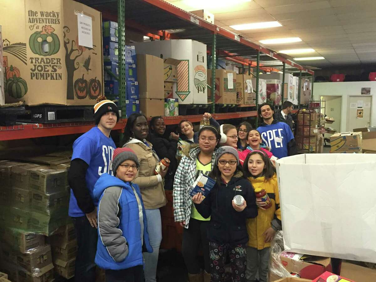 Stark Elementary sCHOOL fifth graders helped sort food at the Food Bank of Lower Fairfield County as part of their service-learning project.