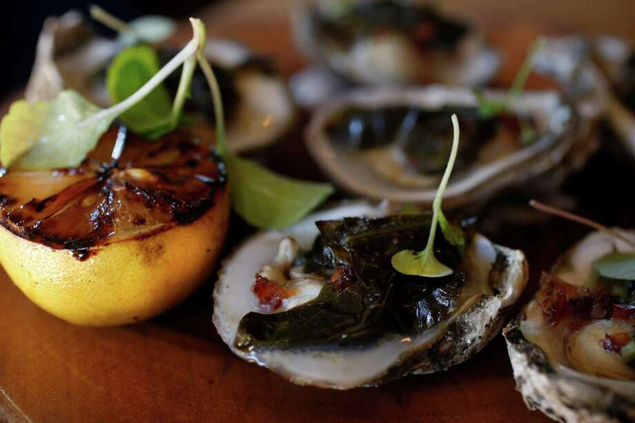 Roasted oysters with pickled collards were perfectly balanced on one visit; on another, the oysters were overly sweet.Roasted oysters with pickled collards were perfectly balanced on one visit; on another, the oysters were overly sweet. Photo: Steve Gonzales / © 2015 Houston Chronicle