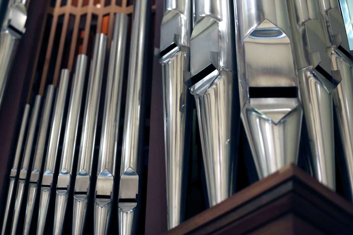 Some of the larger pipes of the Laurel Heights Methodist Church organ are seen Wednesday Dec. 16, 2015 as Curtis Bobsin, owner of C. Bobsin Organs, tunes the pipe organ. The largest pip in the Laurel Heights organ is about 16 feet long according to Bobsin.