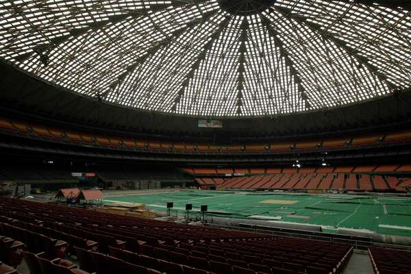 Once touted as the Eighth Wonder of the World, the Astrodome sits quietly gathering dust and items for storage Monday, May 21, 2012, in Houston. The domed stadium was home to the Houston Oilers, Astros and Stock Show and Rodeo along with playing host to the NBA Finals, professional boxing, tennis extravaganzas and numerous high school football playoff games. (AP Photo/Pat Sullivan)
