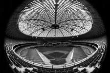 "FILE - This April 1965 file photo made with a fisheye lens shows the Houston Astrodome The Houston Astros played their first game in the stadium on April 9, 1965. A ""yard sale"" and auction got underway Saturday, Nov. 2, 2013 for anyone wanting to buy a memento from the stadium once dubbed the ""eighth wonder of the world."" The sale is being held at the Reliant Center, adjacent to the now-closed Astrodome. (AP Photos, File)"