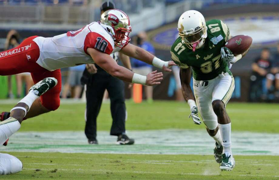 MIAMI BEACH BOWLWestern Kentucky vs. USF: Bluetooth speaker, Oakley backpack, Under Armour bucket hat and sunglasses, beach towel, waterproof cellphone case and commemorative football Photo: Lynne Sladky, AP / AP