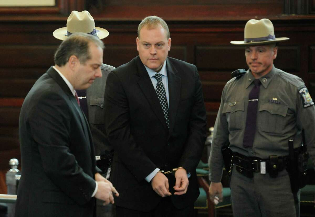 Edward McDonough Jr. is lead in to the courtroom in the Rensselaer County Courthouse in Troy Jan. 28, 2011, to face charges of alleged voter fraud after a Grand Jury handed up sealed indictments naming him and Michael LoPorto (Skip Dickstein / Times Union archive)