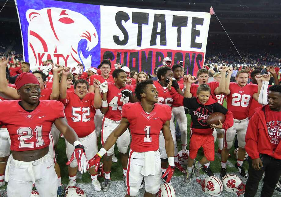Katy's football team celebrates it's 34-7 win over Austin Lake Travis for the 6A Division II championship football game at NRG Stadium on Dec. 19, 2015, in Houston. Katy won the title 34-7. Photo: Elizabeth Conley /Houston Chronicle / © 2015 Houston Chronicle