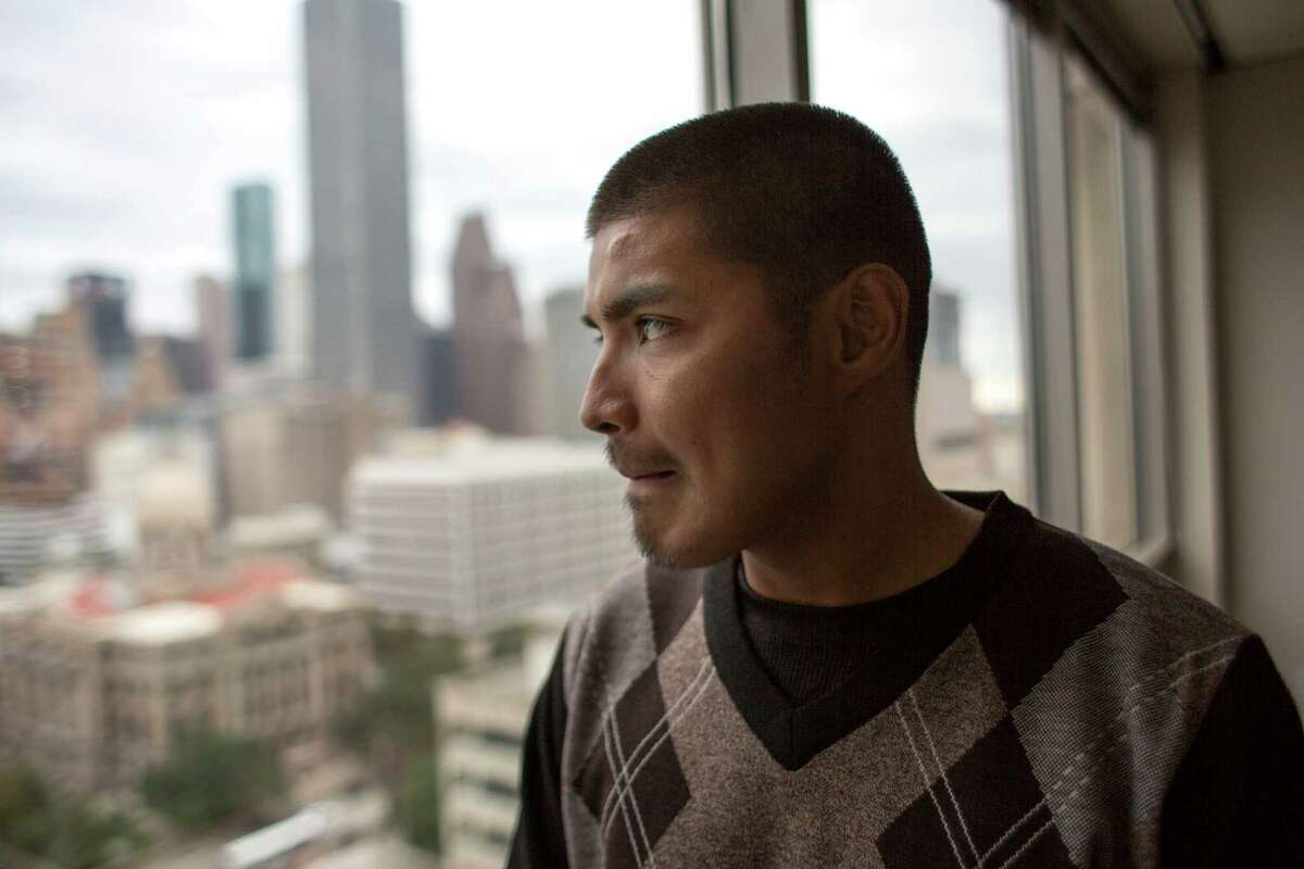 Joseph Salazar looks out a window at the Harris County Public Defender's Office Monday, Oct. 26, 2015, in downtown Houston. Salazar was accused of trying to disarm a peace officer last July. His court-appointed public defender was able to get his case dismissed after he subpoenaed jailhouse video showing the incident.