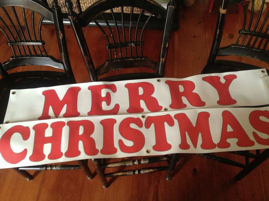 "Elena Marcelle has purchased a new ""Merry Christmas"" banner in case the town reverses its decision to ban written signs from holiday display at the Four Corners intersection. (Photo courtesy of Elena Marcelle)"