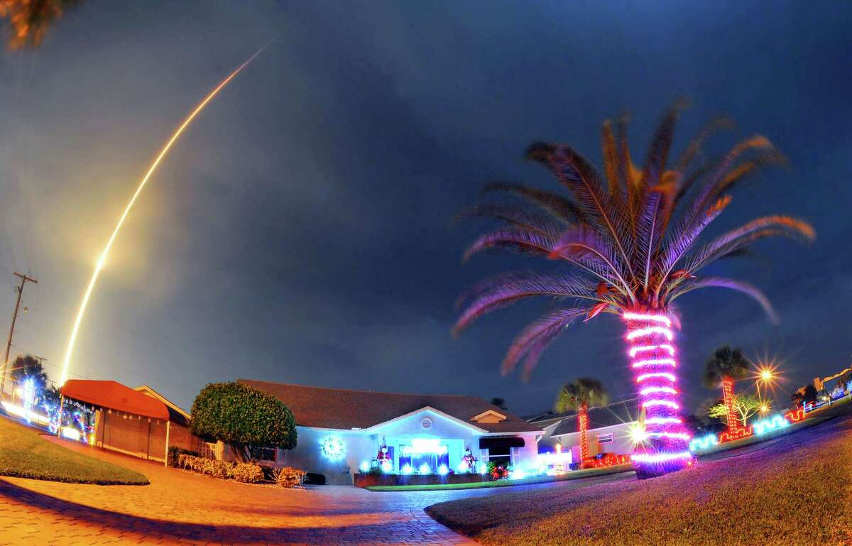 The SpaceX Falcon 9 rocket lifts off over Cocoa Beach, Fla., at Cape Canaveral Air Force Station on Monday.