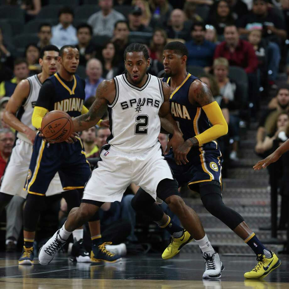San Antonio Spurs' Kawhi Leonard controls the ball against Indiana Pacers' Paul George during the first half at the AT&T Center, Monday, Dec. 21, 2015. Photo: JERRY LARA, Staff / San Antonio Express-News / © 2015 San Antonio Express-News