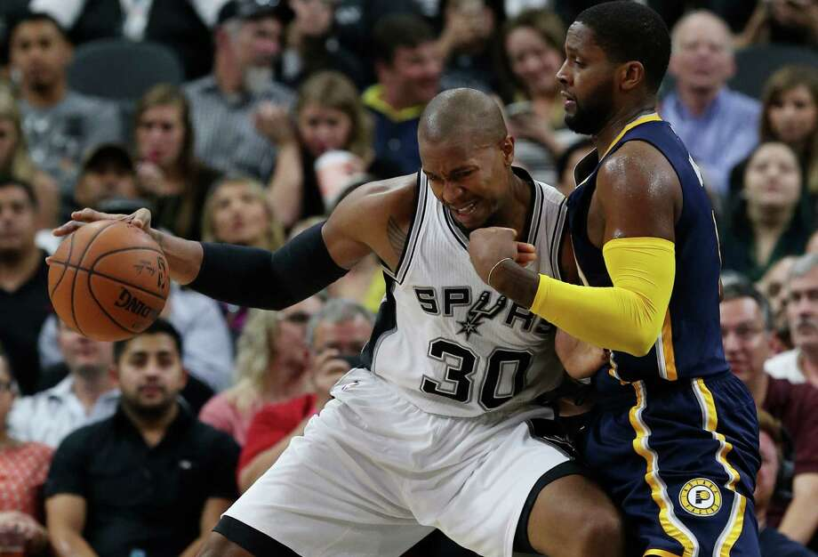 Spurs' David West attempts to get around Indiana Pacers' C.J. Miles during the first half at the AT&T Center on Dec. 21, 2015. Photo: Jerry Lara /San Antonio Express-News / © 2015 San Antonio Express-News