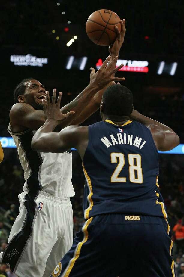 San Antonio Spurs' Kawhi Leonard shoots pver Indiana Pacers'  Ian Mahinmi during the second half at the AT&T Center, Monday, Dec. 21, 2015. The Spurs won, 106-92. Photo: JERRY LARA, Staff / San Antonio Express-News / © 2015 San Antonio Express-News