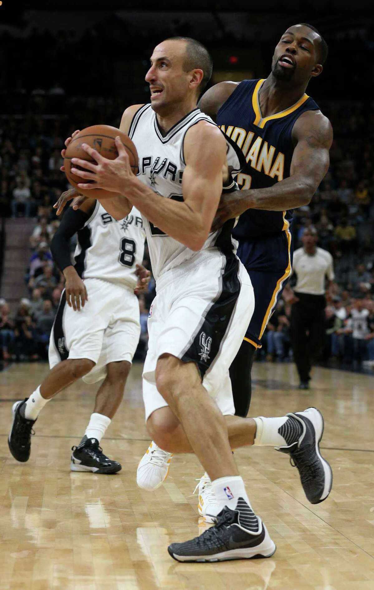 Indiana Pacers' Rodney Stuckey grabs the Spurs' Manu Ginobili during the second half at the AT&T Center on Dec. 21, 2015. The Spurs won, 106-92.