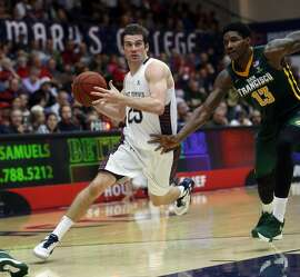 St. Mary's Joe Rahon drives past USF's Dont'e Reynolds in 2nd half during Gaels' 74-52 win in WCC basketball game in Moraga, Calif., on Monday, December 21, 2015.