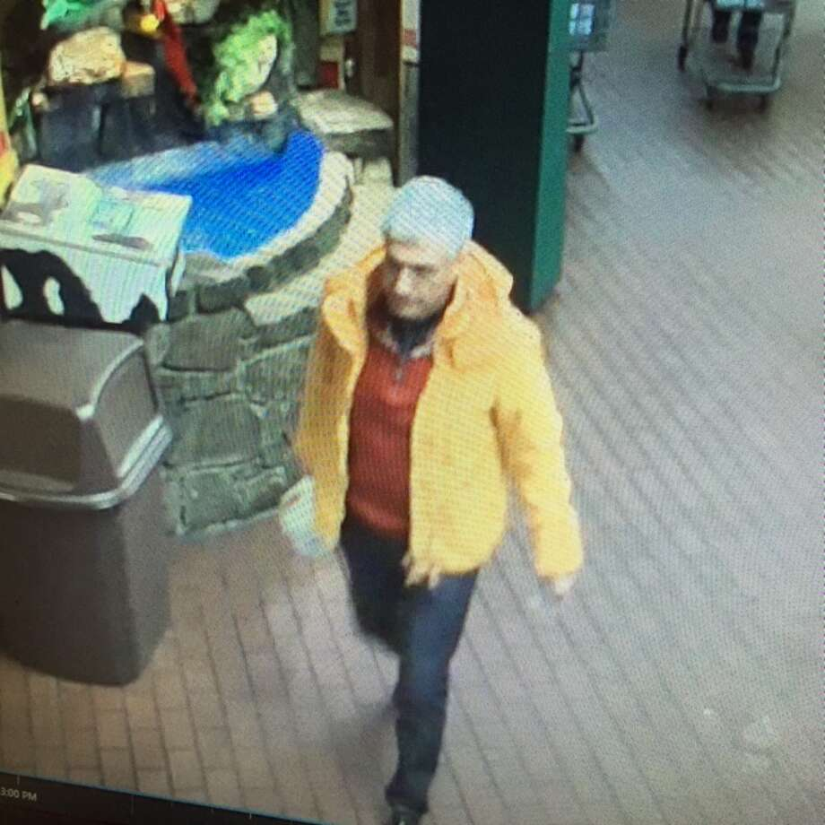 This is the man, Norwalk police say, who is suspected of stealing a Prada designer and Gucci wallet, valued at more than $6,000, from a shopping cart at Stew Leonard's on Dec. 2, 2015. Photo: Norwalk PD Photo